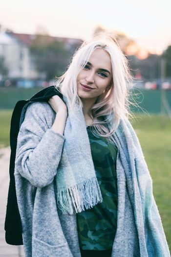 Portrait Fashion Long Hair One Woman Only Women One Person Outdoors Smiling People Blond Hair Beauty City Life Autumn Beautiful People Lighting