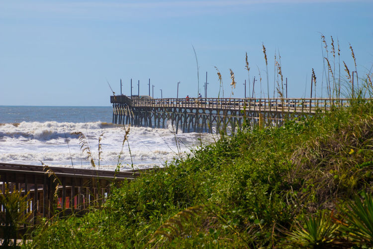 Sunset Beach Pier Beach Beachphotography Fishin Pier Grasses Horizon Ocean Tranquil Seas Wooden Structure