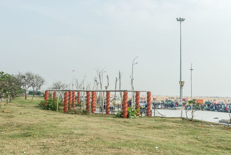 wide of view of sit out area in marina beach decorated with brick stone pillars Architecture Marina Beach, Cheenai,India Architecture Built Structure Day Field Grass Nature No People Outdoors Sitout Sky Tree