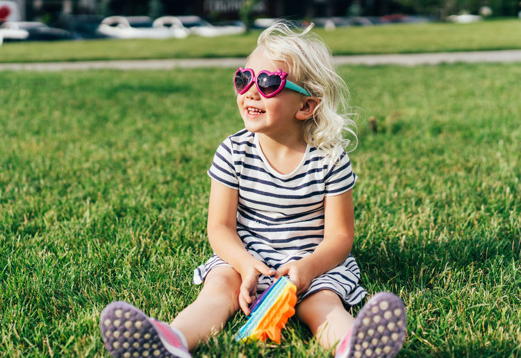 Full length of a girl sitting on field
