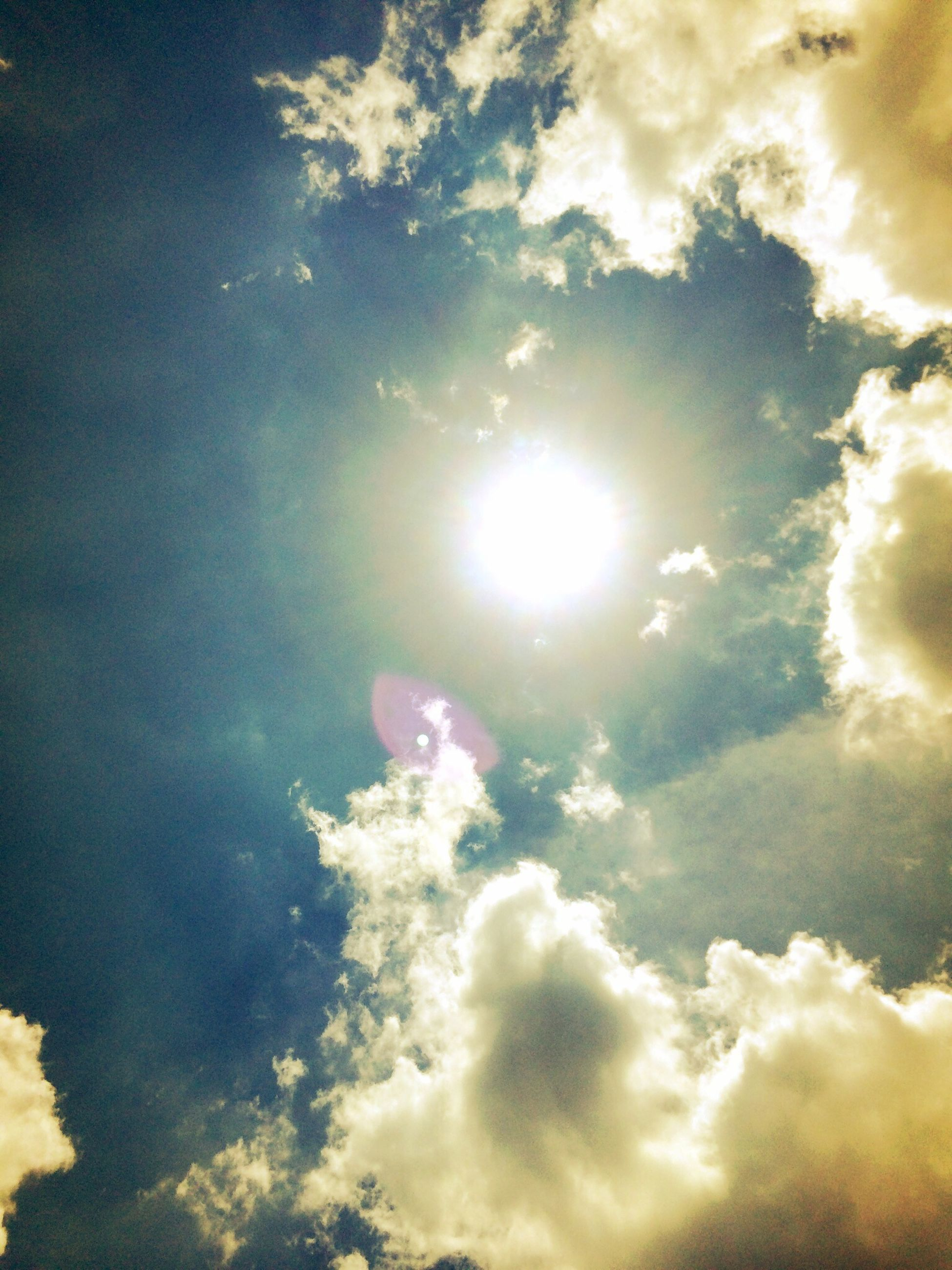 sun, sky, cloud - sky, sunbeam, low angle view, beauty in nature, sky only, sunlight, scenics, tranquility, lens flare, nature, tranquil scene, cloudy, bright, cloudscape, idyllic, cloud, backgrounds, outdoors