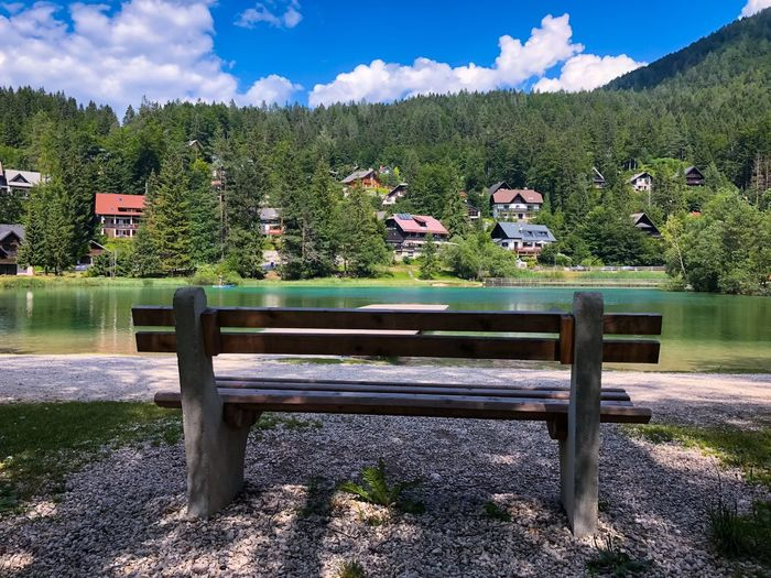 Your zen moment's bench Great Outdoors - 2018 Eyeem Awards Great Outdoors Green Nature Park Bench Park Woods Houses White Clouds Kranjska Gora Lake Jasna Unspoiled Nature Clear Water Emerald Lake Green Lake Waterfront Wooden Bench Bench Sky Nature Cloud - Sky Seat Tree Beauty In Nature Sunlight No People Park Tranquility Outdoors Scenics - Nature Wood - Material