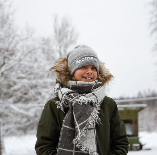 Winter Warm Clothing Cold Temperature Clothing Snow One Person Hat Portrait Smiling Happiness Day Looking At Camera Outdoors Notnow Scarf