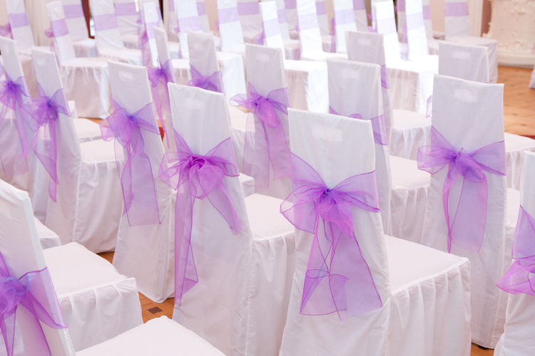 Chair Event Venue Wedding Wedding Venue Bow Celebration Chairs Covered Covered Chairs Covers Decoration Event Indoors  No People Pattern Purple Purple Ribbon Purple Wedding Decoration Ribbon Ribbon - Sewing Item Textile Wedding Ceremony Wedding Day White Color