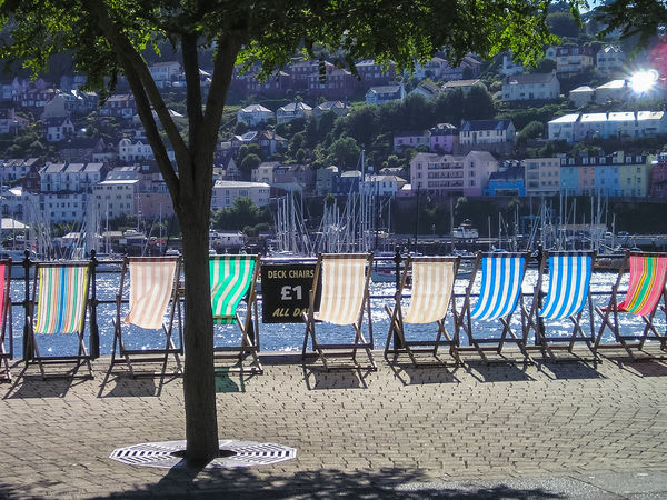 Deck chairs along the edge of The Embankment at Dartmouth in South Devon, UK. Dartmouth Day Deck Chair Deck Chairs Devon Embankment Harbor Harbour Nature No People Out Outdoors Outside River Dart Seating Seats Summer Summertime Sunny Travel Travel Destinations Tree Uk Vacation