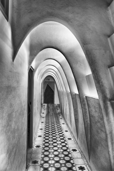 BARCELONA - AUGUST 9: Catenary arcs in the penthouse of Casa Batllo, renowned building designed by Antoni Gaudi and iconic landmark in Barcelona, Catalonia, Spain, on August 9, 2017 Architecture Built Structure Arch Indoors  Direction Arcade The Way Forward Building In A Row Corridor Architectural Column No People Day Diminishing Perspective The Past History Ceiling Repetition Footpath Colonnade Arched Long