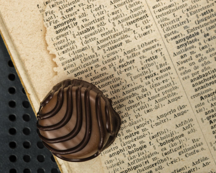 sweet amour Book Chocolate Chocolate♡ Close-up Communication Data Dictionary France French French Language Ink Law Message News Event Newspaper No People Old Old Book Page Paper Romantic Sweet Sweets