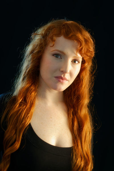 Black Background Redhead Adult Adults Only Beautiful Woman Beauty Black Background Close-up Curly Curly Hair Fair Skin Ginger Headshot Long Hair Looking At Camera Medium-length Hair One Person One Young Woman Only People Portrait Real People Red Hair Redhead Studio Shot Young Adult Young Women