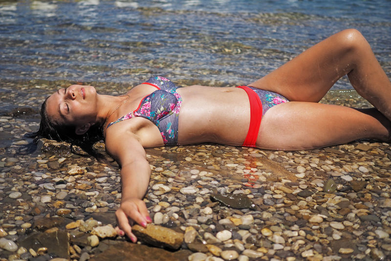 Adriatic sea, Slovenia Slovenia Slovenia ❤ Adriatic Adult Beach Beautiful Woman Capodistria Clothing Day Hairstyle Izola- Slovenia Koper Leisure Activity Lifestyles Lying Down Nature One Person Outdoors Pebble Real People Solid Water Women Young Adult Young Women