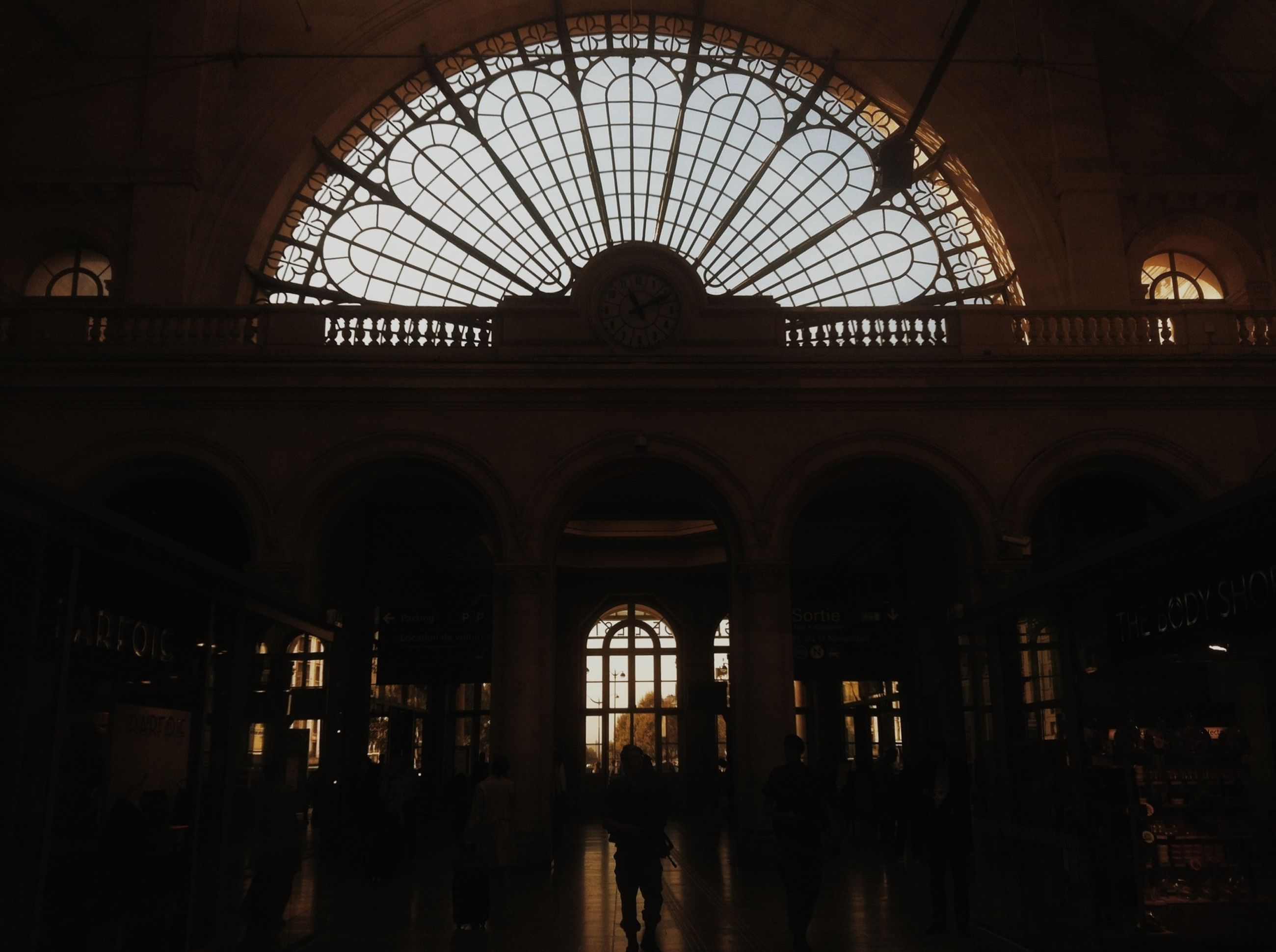 indoors, architecture, arch, built structure, window, ceiling, interior, clock, glass - material, low angle view, railroad station, time, history, building, travel, day, skylight, incidental people, travel destinations