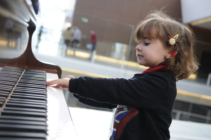 Adorable little girl having fun playing the piano Musical Equipment Childhood Musical Instrument Child Music Piano One Person Arts Culture And Entertainment Real People Playing Girls Leisure Activity Lifestyles Females Musician Innocence Piano Key Cute
