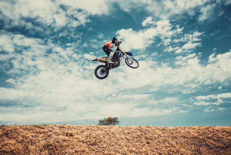 Motocross racer jumping high