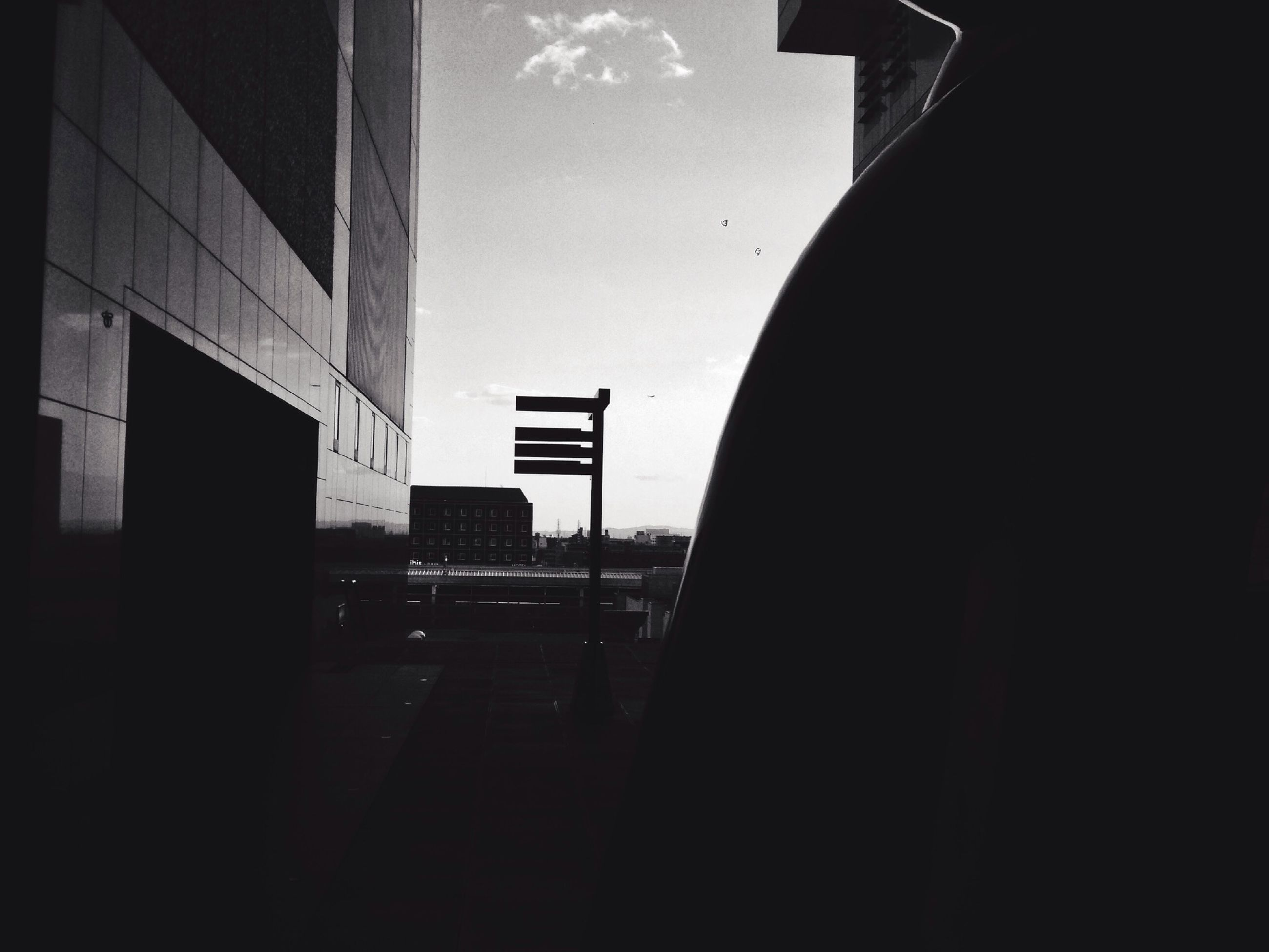 architecture, built structure, building exterior, indoors, building, window, sky, city, silhouette, the way forward, dark, transportation, sunlight, no people, diminishing perspective, day, residential structure, low angle view, street, clear sky