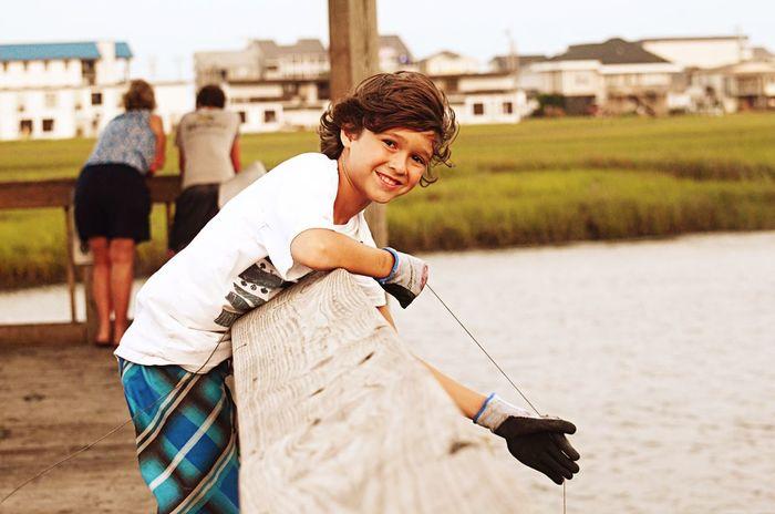 Smile Smiling Boy Lowcountry South Carolina Crabbing Catching Dinner Crab Marsh Inlet Garden City SC