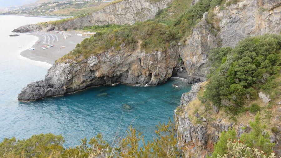 Arcomagno beach , Calabria Arcomagno Beach Beautiful Beauty In Nature Calabria (Italy) Coast Dino Excursion Holidays Praia A Mare Relax Rock San Nicola Arcella Sea Tourist Attraction  Tourist Destination Umbrellas Vacations
