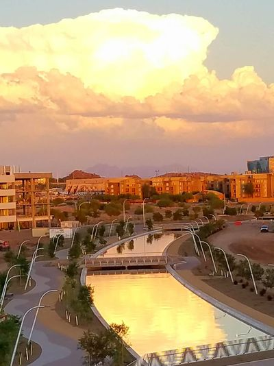 Phoenix, over near the airport. Lots of building going on. Beautiful Evening Clouds And Sky , Reflections In The Water , Buildings , Sunset
