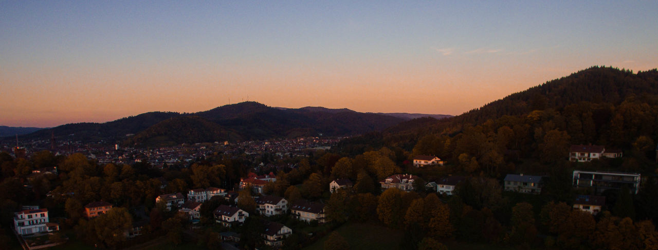 Panoramic view of town against sky during sunset