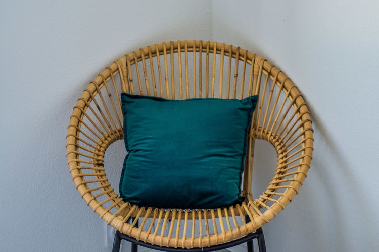 High angle view of wicker basket on table against wall