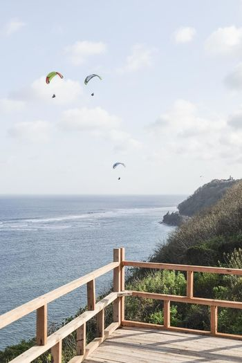 Adventure Beauty In Nature Cloud - Sky Day Extreme Sports Horizon Horizon Over Water Nature Non-urban Scene Outdoors Parachute Paragliding Railing Scenics - Nature Sea Sky Sport Tranquil Scene Tranquility Water