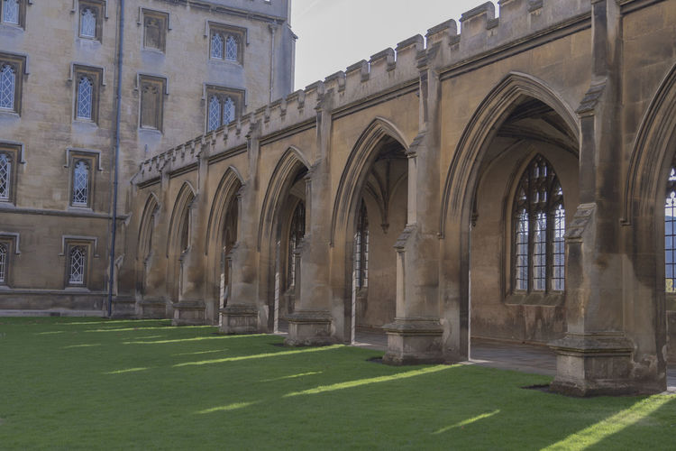 Architecture Building Exterior Arch The Past Day Building Grass History Window Architectural Column No People Travel Destinations Arcade Travel Tourism Courtyard  Colonnade Stone Wall Stone Arch Ancient Ancient Architecture Cambridge England Green Grass Sunlight And Shadow