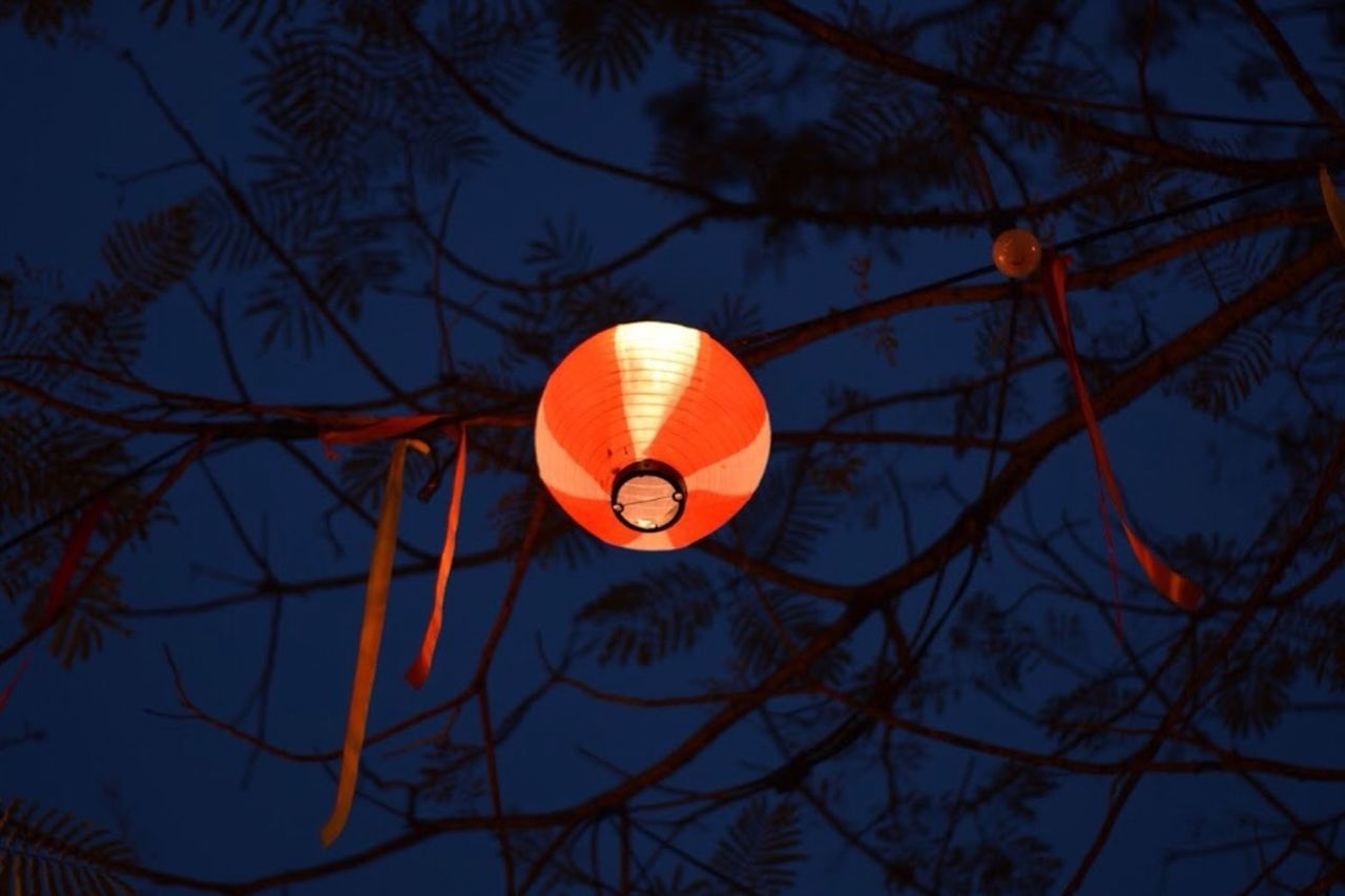 LOW ANGLE VIEW OF LANTERN AGAINST SKY AT NIGHT
