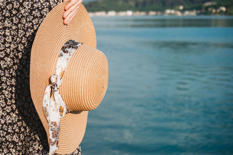 Close-up of hat hanging on beach