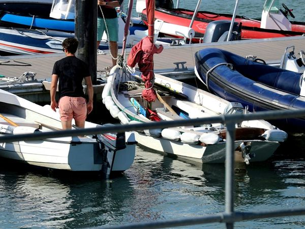 Dockside Dockside Dockside View Dinghies Rigid Inflatable Boat Outboard Motor Nautical Vessel Transportation Water Mode Of Transport Moored Day Adults Only Adult Sea People Outdoors One Person Men Only Men One Man Only Baltimore Ireland West Cork Wildatlanticway Ireland