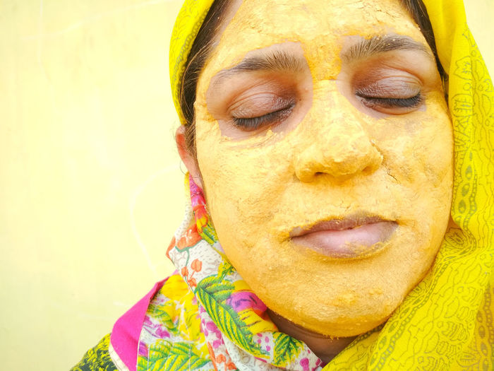 Honemade Facial Mask - Beauty Product Facial Skincare Beauty Treatment Layering Beauty Beautiful Eyes Closed  Indian Facepack Woman Face Fashion Portrait Human Face Yellow Headshot Beauty Close-up Powder Paint Posing Indian Culture  Festival Face Powder Traditional Festival Anti Aging Skin Care Spa Treatment Beauty Spa