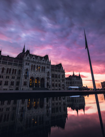 hungarian parliment building from behind, kossuth square at a colorful sunset Sky Sunset Building Exterior Water Cloud - Sky Reflection Built Structure Architecture Waterfront Nature Dusk No People Dramatic Sky Building Travel Destinations Orange Color Lake City Parliment Tourist Attraction  Reflection Colorful