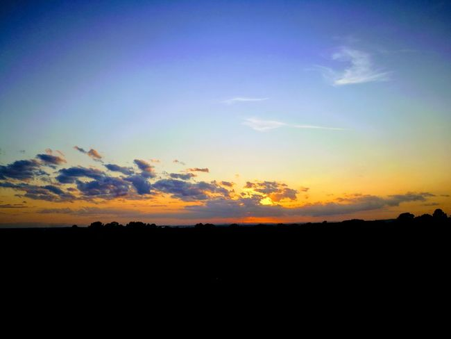 Sunset Landscape Sky Outdoors Tranquility Nature No People Cloud - Sky Rural Scene Beauty In Nature Horizon Blue Multi Colored