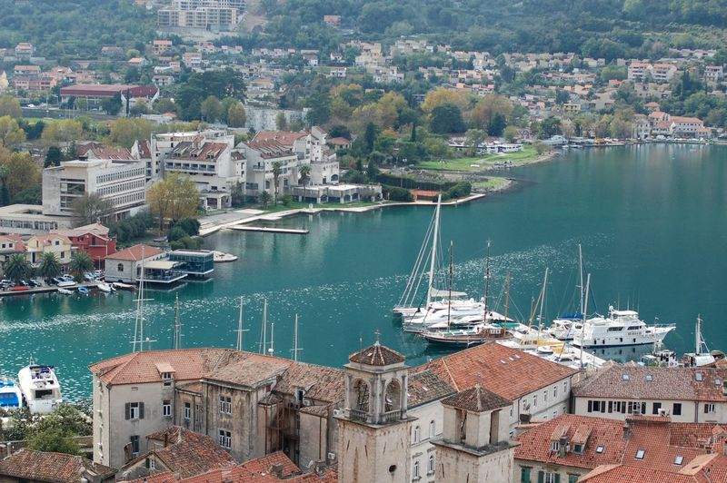 Bay Boka Kotorska Canal City City Life Cityscape Harbor Harbour High Angle View House Kotor Montenegro Nautical Vessel Outdoors Residential Building Residential District Residential Structure Roof Roof Rooftop Sea Town TOWNSCAPE Travel Destinations Water