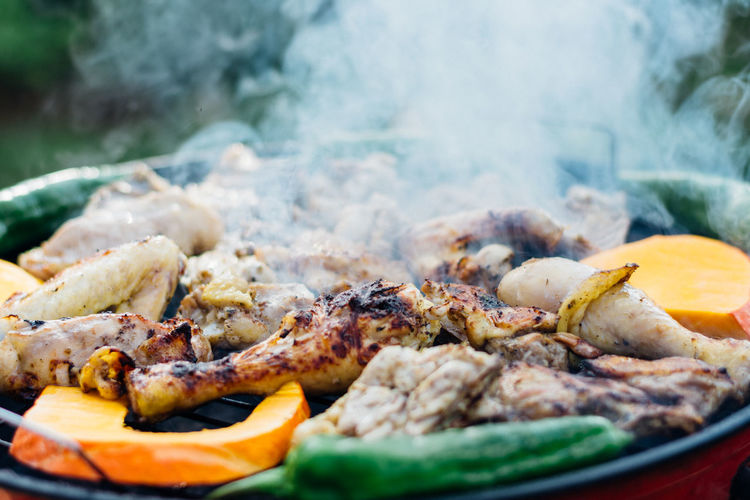 Close-up of meat and vegetables on barbecue grill