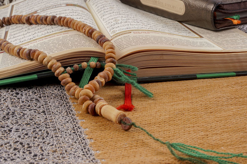 Al Quran on wooden table. Education concept Devotion Reading Time Al Quran Book Deeds Education Holy Top View