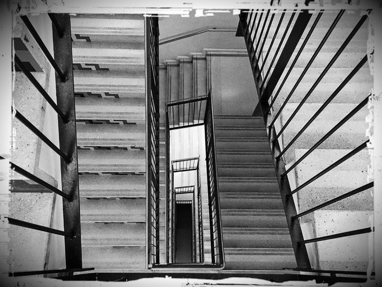 Stairs to the wicked guts of the laboratory. Mobilephotography Xperiagraphy Pocketcamera Blackandwhite Monochrome Monochrome World No People Lumiocam Pixlr Creepy Vanishing Point Old Places Steps And Staircases Spiral Hospital