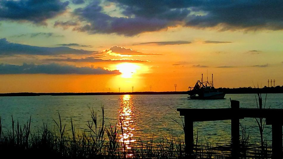 Sunset Sea Nautical Vessel Reflection Water Pier Cloud - Sky Silhouette Sky Horizon Over Water Scenics Tranquility River Mississippi  Beauty In Nature Pascagoula Mississippi  No Worries Tranquil Scene Peaceful Place Quiet Places Secret Hideaway After The Rain Came The Sun