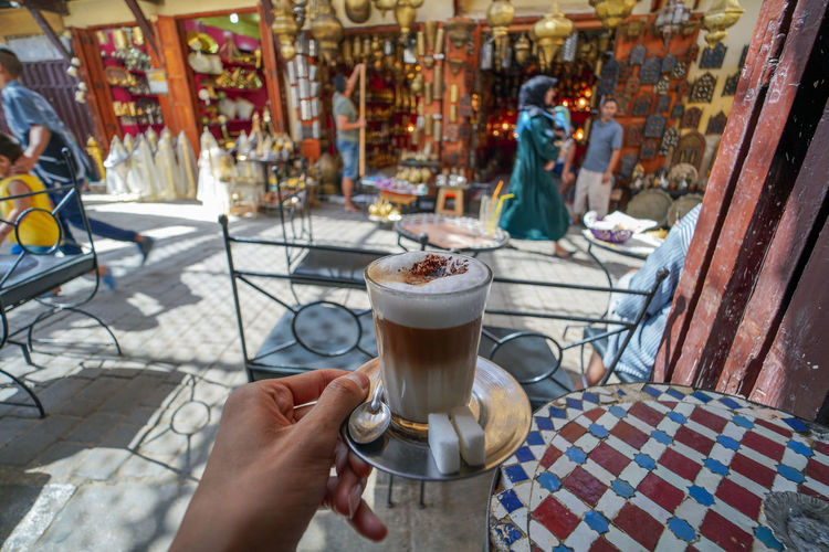 cafe break. Fes Morocco Travel Destinations Travel Photography EyeEmNewHere Travelling Digital Nomad Drink Food And Drink Refreshment Holding Hand One Person Human Hand Real People Coffee - Drink Coffee Lifestyles Human Body Part Table Leisure Activity Day Glass Cafe Cup Mug Household Equipment Frothy Drink