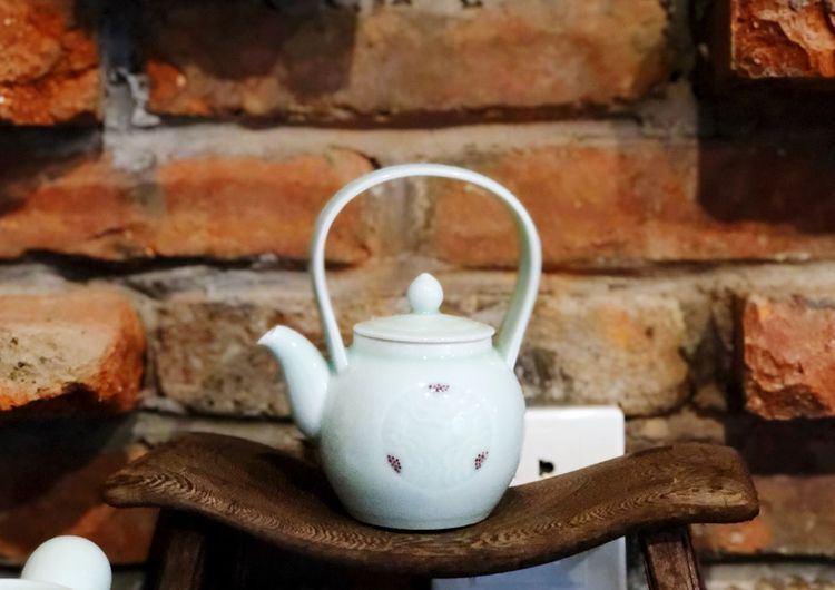 Teapot Food And Drink Wall Brick Wall Drink Cup Brick Mug Focus On Foreground Refreshment Wall - Building Feature Still Life Hot Drink Household Equipment Tea Tea - Hot Drink Indoors  Close-up No People Ceramics