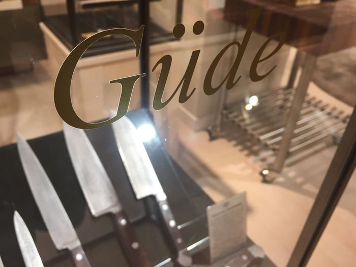 Berlin, Germany - January 27, 2018: Güde logo. The Gude Knife Company of Solingen, Germany, makes forged knives in small numbers, entirely by hand Company Knife Logo Brand Close-up Editorial  Gude Indoors  Knives No People Symbol