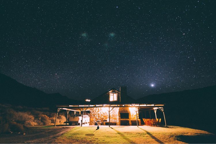 Built structure against star field at night