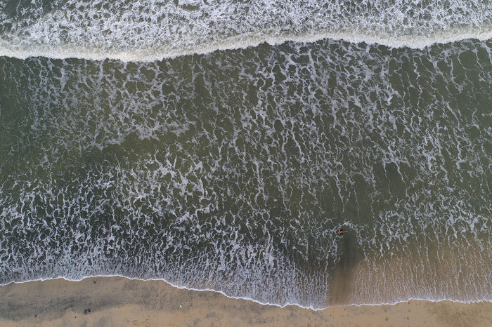 Beach Aerial Aerial Photography Aerial Shot Aerial View Beach Beach Life Beachphotography Beauty In Nature Day Leisure Activity Nature One Person Outdoors Pattern Pattern Pieces People Sea Water Wave
