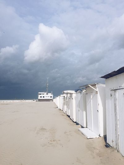 I love these beach cabins along the Flemish coast. Sky Cloud - Sky Beach Outdoors Sea Architecture Day Sand Built Structure Nature Building Exterior No People