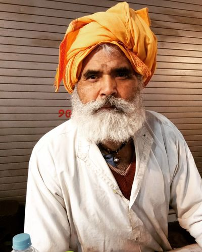 Traditional Indian Man , with Turban on his head .... Click was captured while I was exploring Sarafa Food Market Indore ... The was a Street Vendor selling Water Bottles... Manwithhat Turban India Facesofindia Portrait Beard Real People Mustache First Eyeem Photo