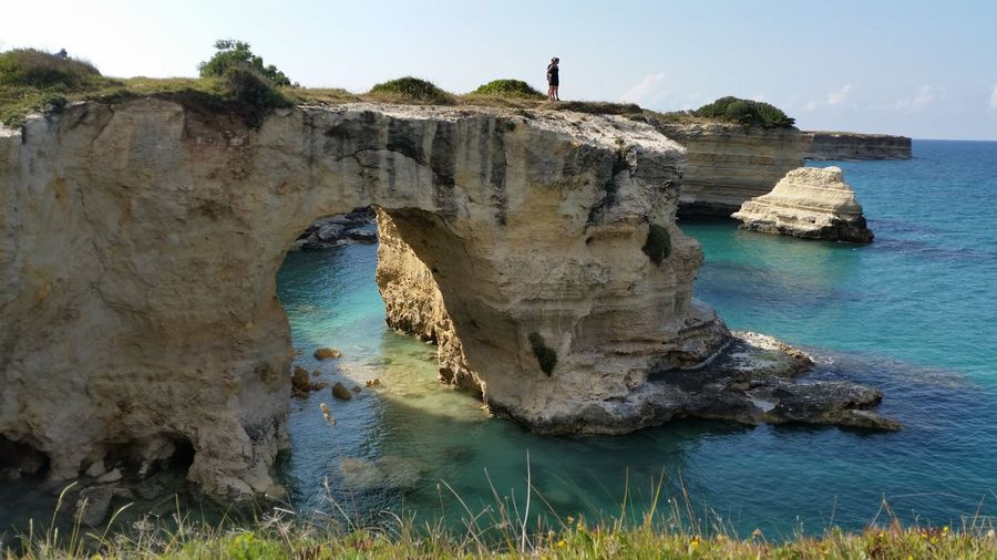 Torre san Andrea Beach Beauty In Nature Blue Cliff Coastline Geology Horizon Over Water Idyllic Incidental People Nature Rock Rock - Object Rock Formation Scenics Sea Shore Sky Tranquil Scene Tranquility Water Feel The Journey