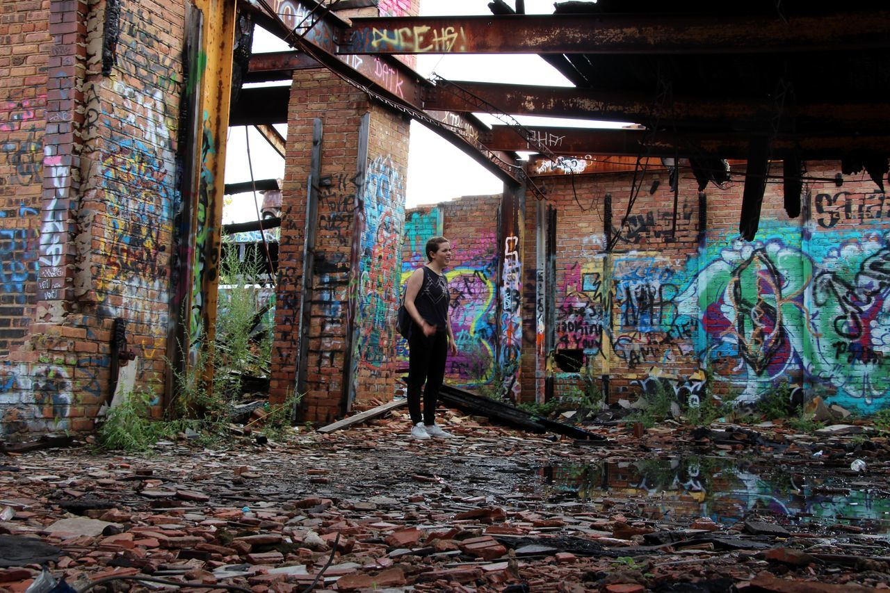 Full Length Of Woman Standing In Abandoned Building