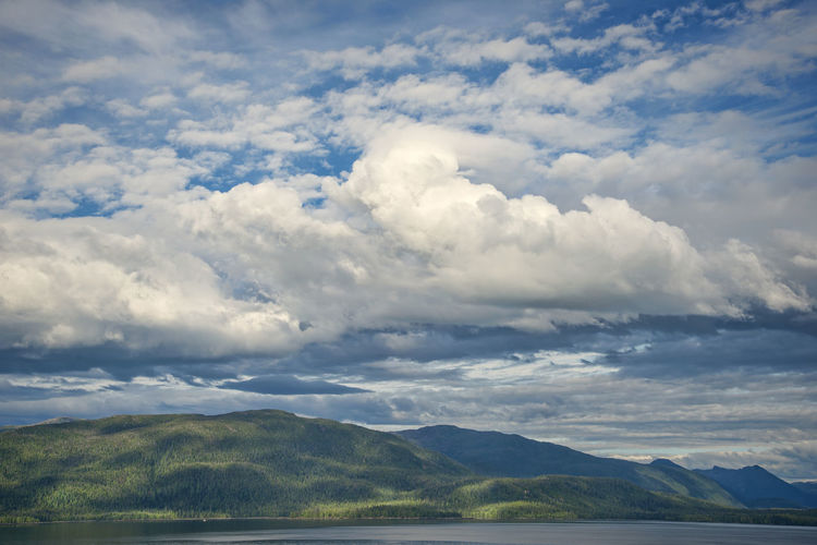 Water Mountain Cloud - Sky Scenics - Nature Sky Beauty In Nature Mountain Range Tranquil Scene Tranquility Nature Day Non-urban Scene No People Outdoors Wilderness Area Alaskan Nature Ocean Shoreline Dramatic Sky