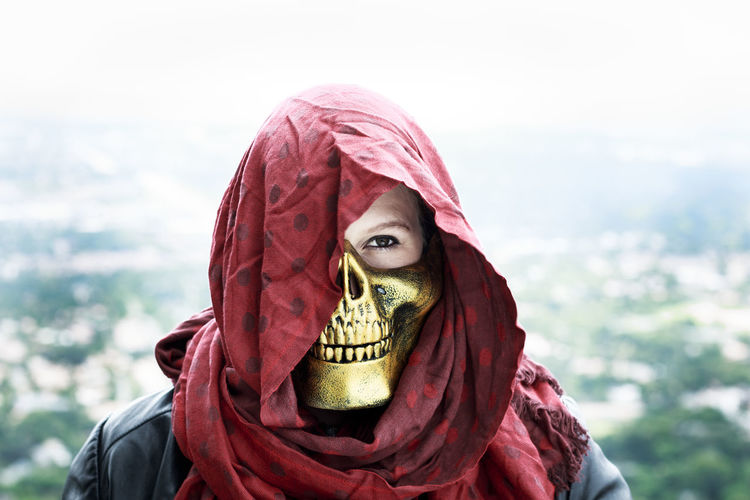 Portrait Of Woman Wearing Spooky Mask And Headscarf