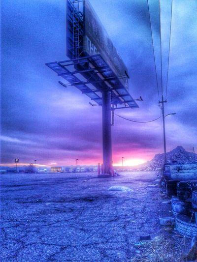 Electricity pylon on landscape against sky