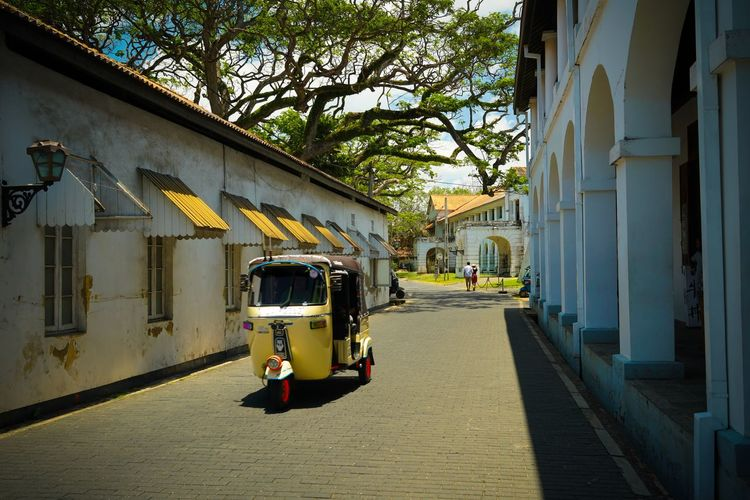 TukTuk Architecture Built Structure Tree Building Exterior Plant Transportation Nature Sunlight Direction Mode Of Transportation City The Way Forward Day Shadow Building Outdoors Street Incidental People Land Vehicle Diminishing Perspective