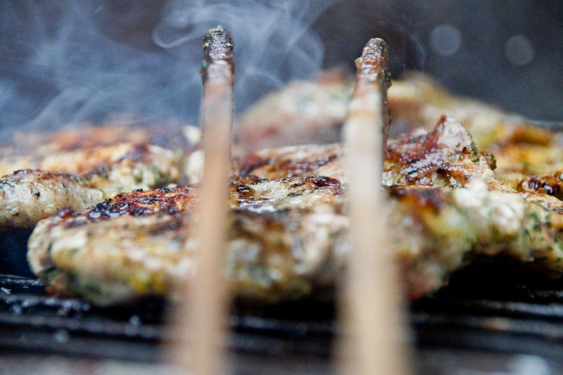 Close-up of pork cooking on barbecue grill