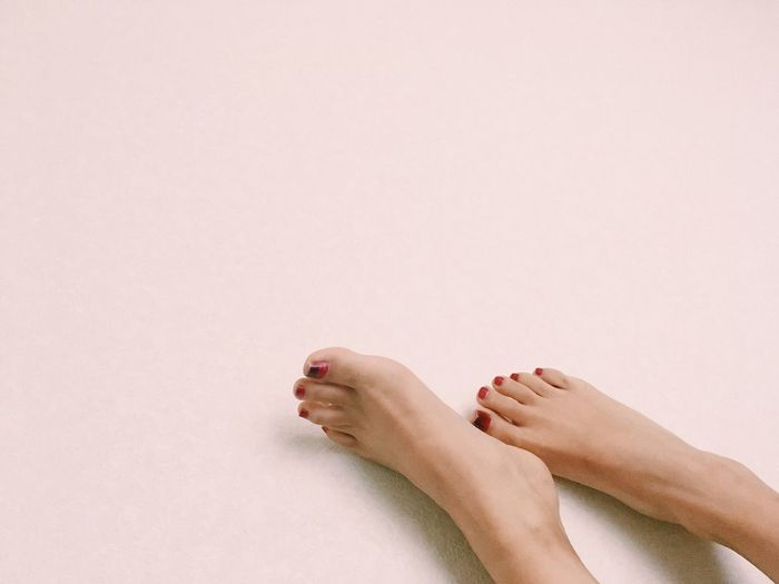 Human Body Part Human Leg Body Part Human Foot Low Section barefoot Women Adult One Person Relaxation Copy Space Indoors  Human Limb Nail Polish Limb Personal Perspective Body Care Lifestyles Beauty Nail
